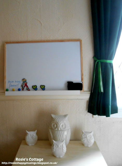A New Planning & Organising System - a new magnetic notice board sits on the picture ledge with magnets, a pen and an eraser