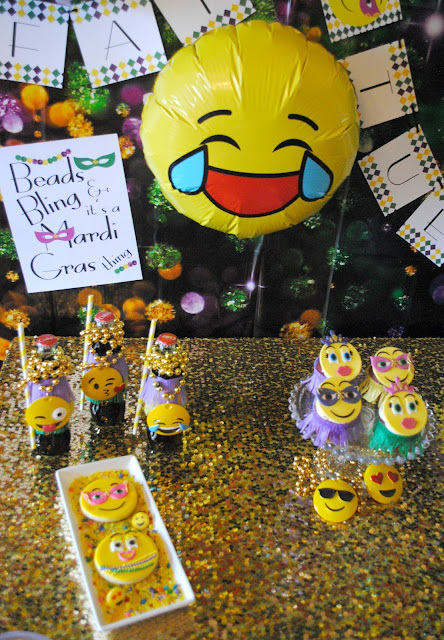 Beads, Bling and emojis make up this Mardi Gras party by Fizzy Party