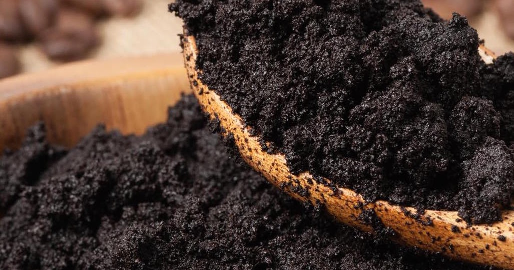 washing face with coffee grounds