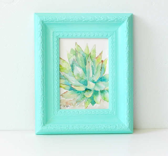 Turquoise painted thrifted picture frame with watercolor cactus
