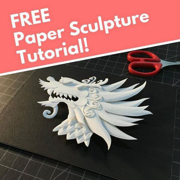 paper sculpture tutorial of all-white dragon head on black background