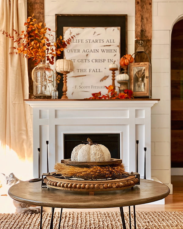 fall mantel with pumpkins, leaves, wood tray and F. Scott Fitzgerald quote sign