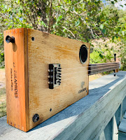 cigar box guitars for sale, primitive instruments, handmade guitars, where to buy a cigar box guitar