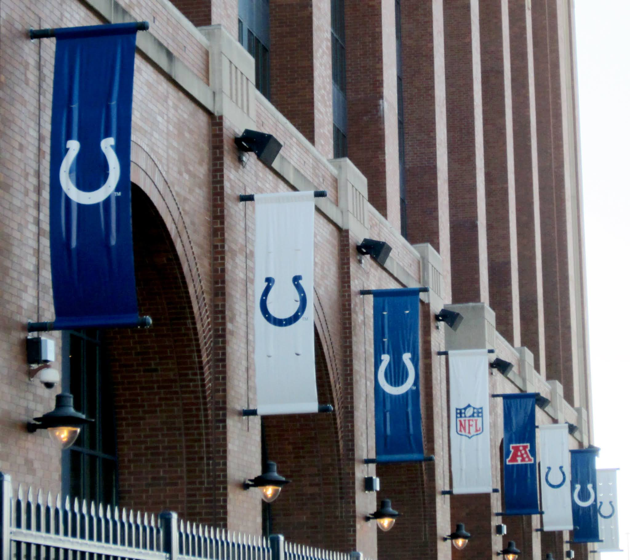 Indianapolis Colts flags outside Lucas Oil Stadium