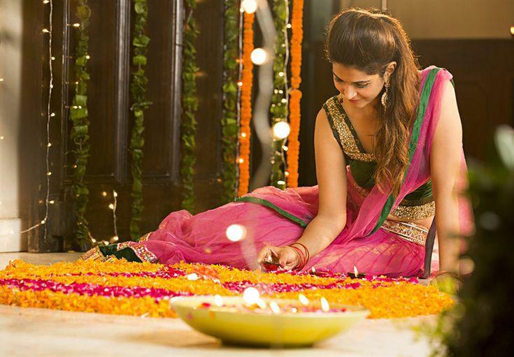 girl making rangoli pose