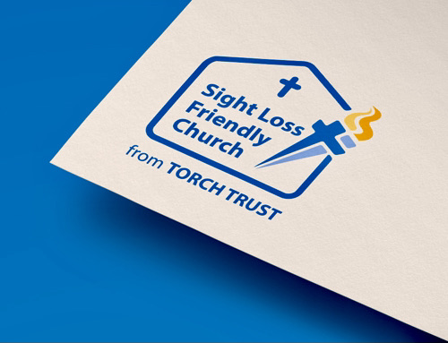 "Blue Background with corner of White page featuring Sight Loss Friendly Church Logo. Text reads: ""Sight Loss Friendy Church. From Torch Trust."""