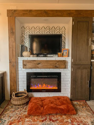 Faux mantel and brick wallpaper used in RV makeover