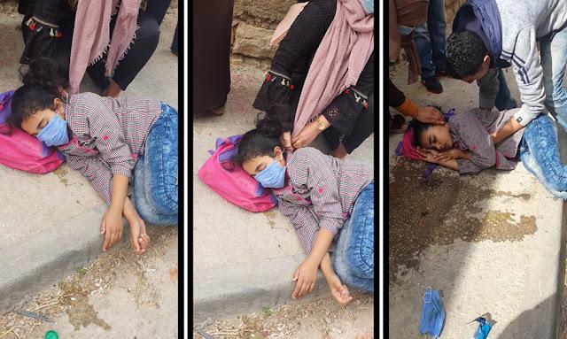 """يحدث في تونس : بالفيديو ... مدير المدرسة الابتدائية """"علي القلصادي بباجة"""" يلقي بتليذة في شارع بعد الاشتباه انها مصابة بـ كورونا"""