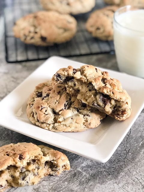 large chocolate chip cookies on a white plate