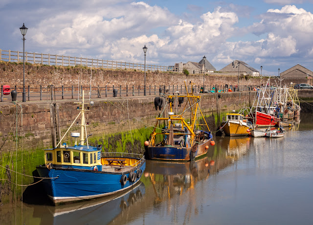 Photo of colourful fishing boats at Maryport Harbour