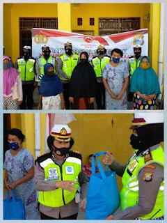 Wakasat Lantas  Beserta Anggota Sat Lantas  Polrestabes Makassar Bagikan Sembako Pada Masyarakat