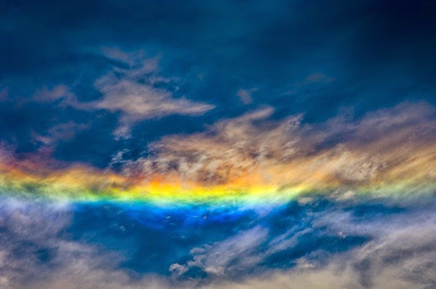 "5. Fire rainbows: These colorful clouds can usually be seen in the summers of middle-latitude areas, such as most of the United States. They are a large halo of refracted light that occur when the sun is at least 58 degrees above the horizon and when there are cirrus clouds in the sky that are filled with plate-shaped ice crystals. The halos tend to be so large that only small parts of them are seen by the naked eye (thus they look like tongues of fire). The proper name for a fire rainbow is a ""circumhorizontal arc."" - Sometimes Nature Is Awesome. Other Times, It'll Scare The Life Out Of You. Like This."