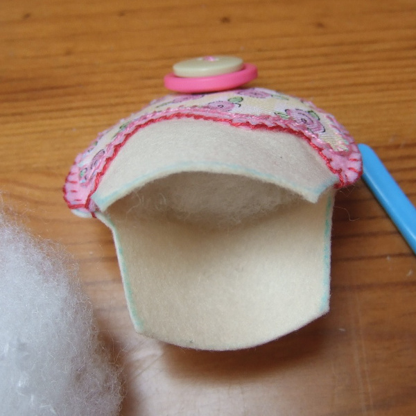 Adding fiber fill stuffing inside a homemade felt plushie