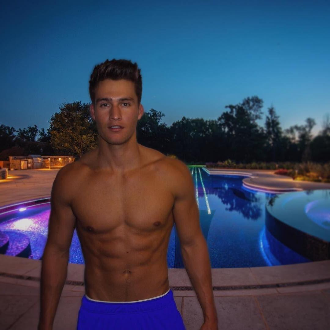 beautiful-male-model-fit-shirtless-body-great-face-blue-shorts-pool
