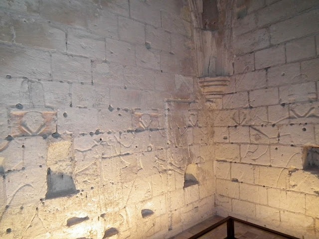 16C graffiti by Protestant soldiers, Loches, Indre et Loire, France. Photo by Loire Valley Time Travel.