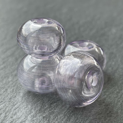Handmade hollow lampwork glass beads made with CiM Bewitched