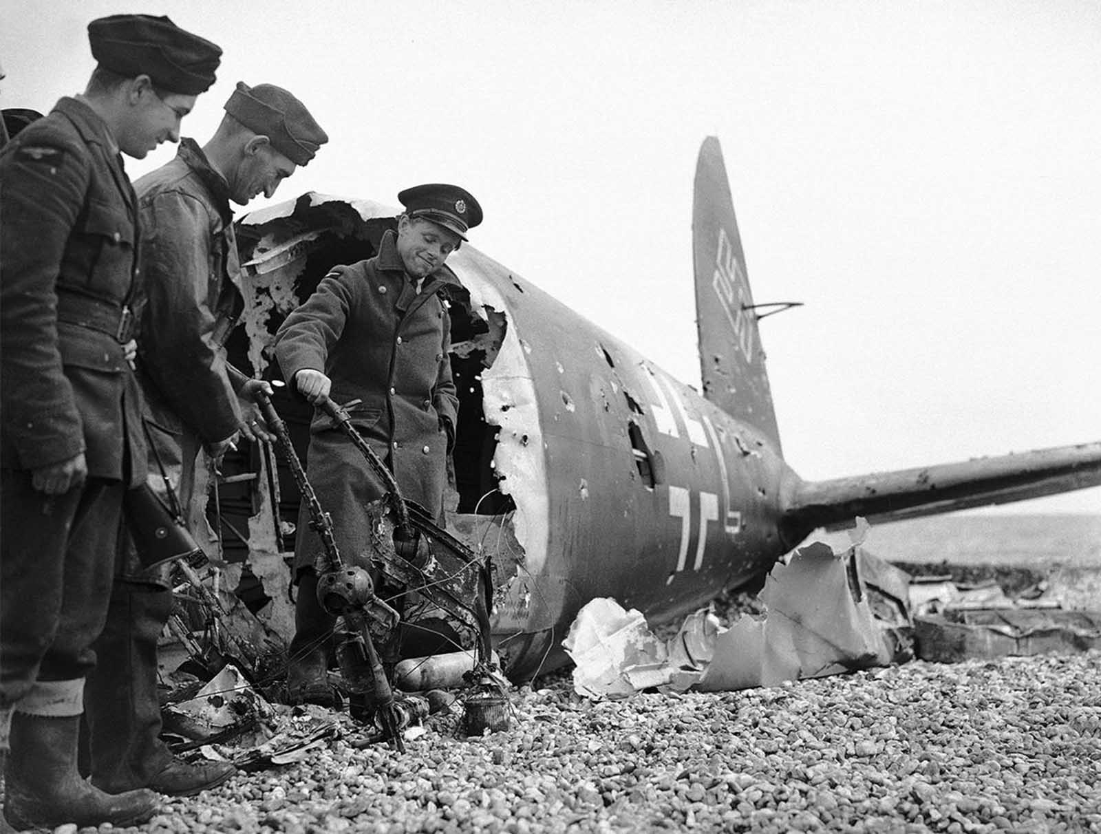 All that remains of a German bomber brought down on the English south-east coast, on July 13, 1940. The aircraft is riddled with bullet holes and its machine guns were twisted out of action.