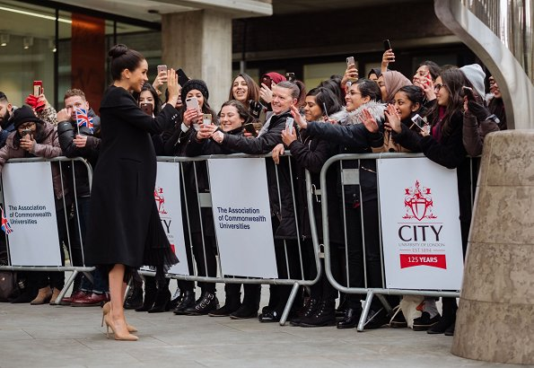 Meghan Markle wore a Bespoke Caplet Coat by Givenchy, and a new bespoke skirt
