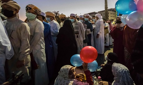 """Eid Prayer on 14 May 2021, foreign students wearing masks before heading to pray Eid prayer at Al Azhar Mosque """"AFP"""""""