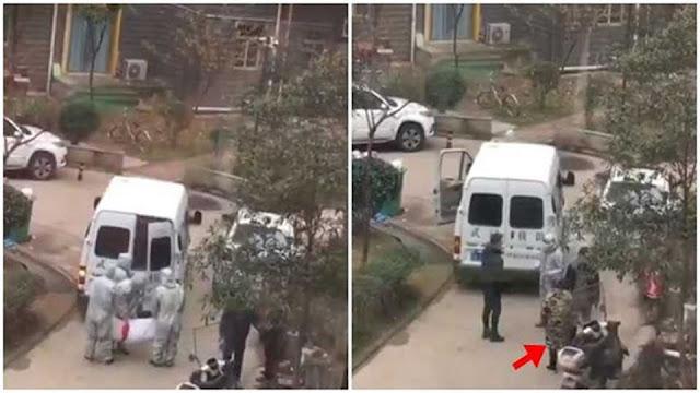 Video người mẹ ở Vũ Hán đuổi theo xe chở xác chất đầy thi thể, khóc xé ruột: 'Con trai tôi'