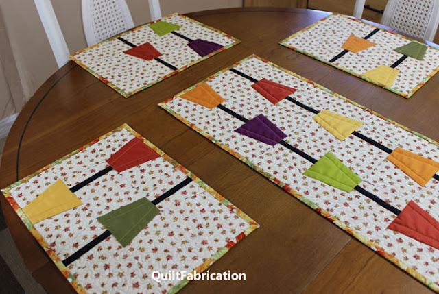 fall colored tumbler blocks on a leaf background fabric