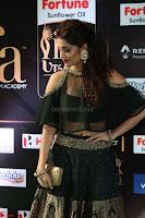 Ritika Singh in a Ethnic Deep Neck Dark Green Choli Ghagra at IIFA Utsavam Awards March 2017 ~ 052.JPG