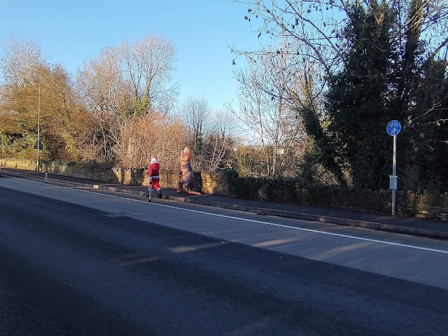 Santa and #ChippenhamDino heading off into the distance