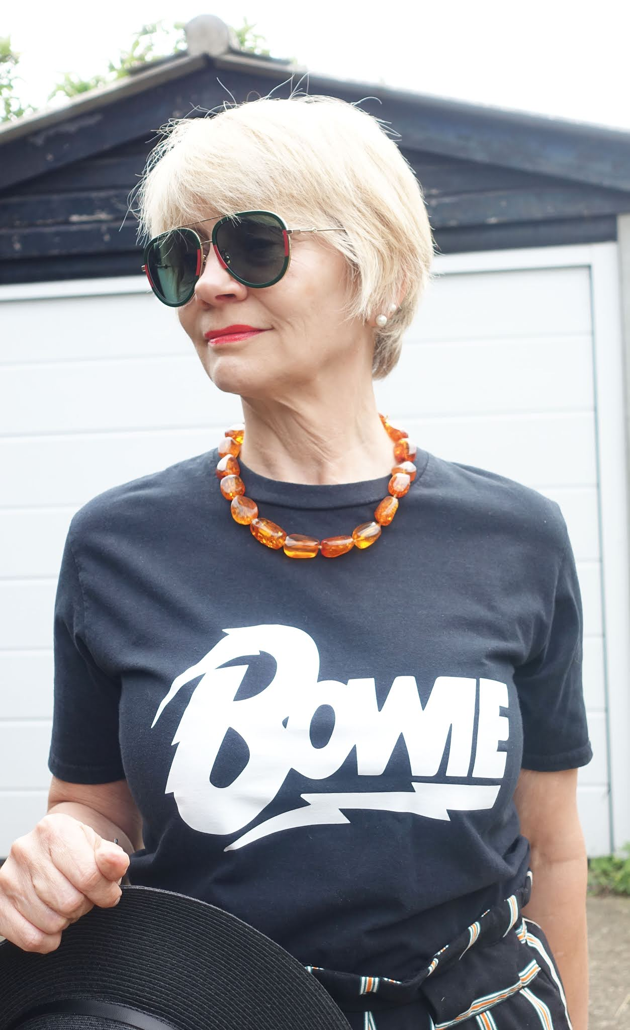 If the weather's good and your picnic is in the UK, how about a slogan tee with paperbag trousers and comfortable Vionic wedges? Not to mention your Gucci prescription sunglasses, as worn by Gail Hanlon from over-50s style blog Is This Mutton