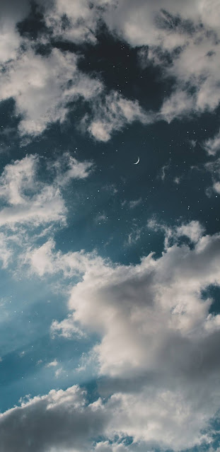 Crescent moon in the cloudy sky