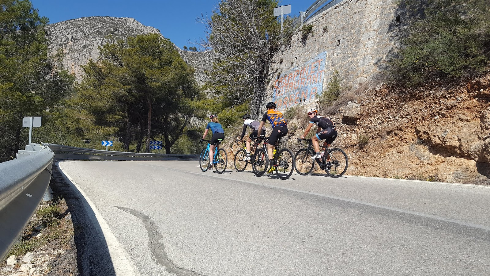 Group of cyclists climbing Coll de Rates from Callosa d'en Sarrià