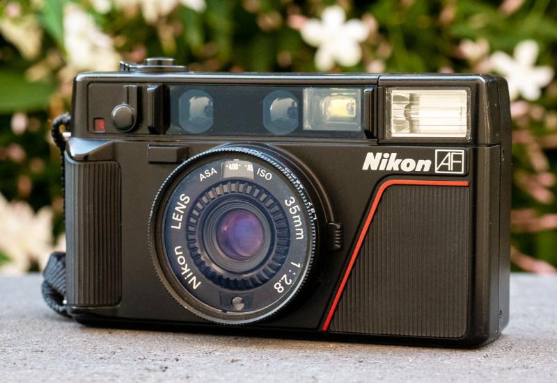 Sejarah Kamera Nikon lensa baru dengan Asa 100