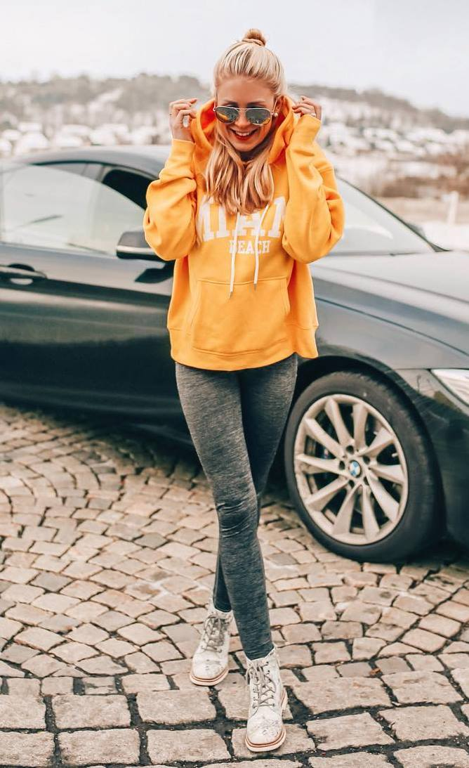 cozy fall outfit / boots + yellow hoodie + leggings