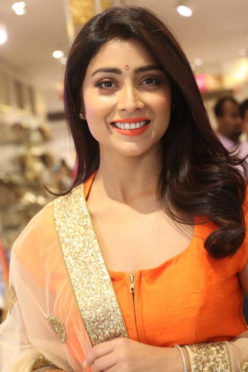 Shriya Saran Latest Photos In Orange Dress