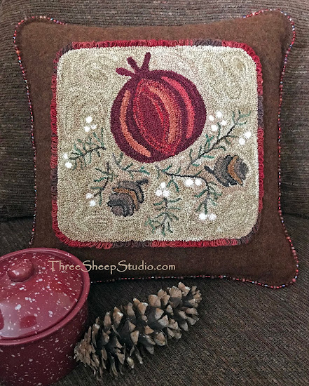 Holiday Pomegranate Wool Pillow Trimmed with a Glass Beaded Edge by Rose Clay at ThreeSheepStudio.com