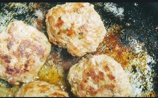 Golden brown galouti kebab on pan for
