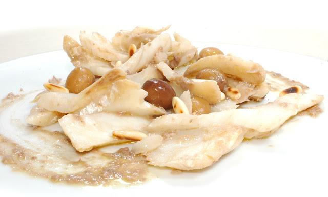 stoccafisso lesso, pinoli tostati, olive taggiasche e salsa marinaresca
