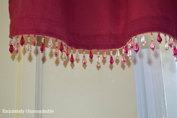 Red valances with beads added for interest