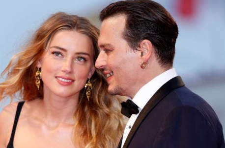 Amber Heard's legal team moved from former Johnny Depp to am 50 million defamation lawsuit,