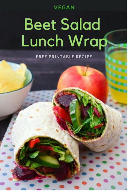 A salad wrap with a powerhouse of flavours and textures including pickled baby beets, sundried tomatoes and pesto. Suitable for vegans. Free printable recipe. Perfect for lunchboxes. #backtoschool #lunchbox #lunchboxes #veganlunch #veganlunchbox #veganwraps #vegansandwiches #vegetarianlunchbox #vegetariansandwich #vegetarianwrap #wrap #beetroot #beets