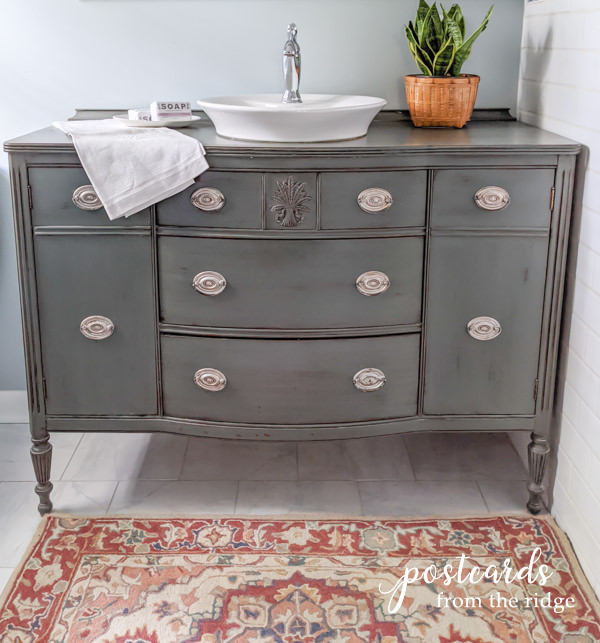 a vintage dining room buffet is repurposed into a bathroom vanity