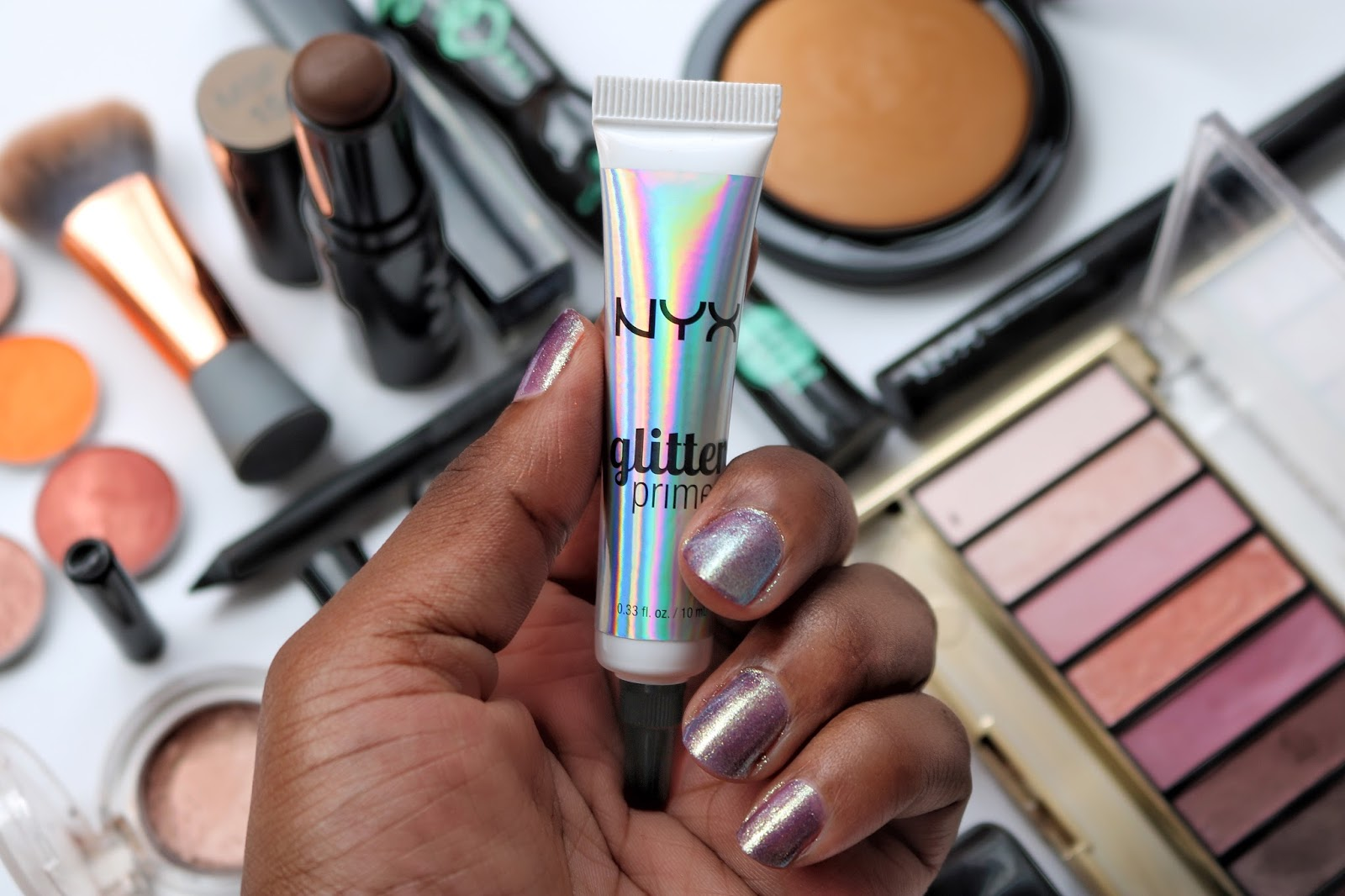 NYX Professional Glitter Primer is great for glitter and shimmer eyeshadow.
