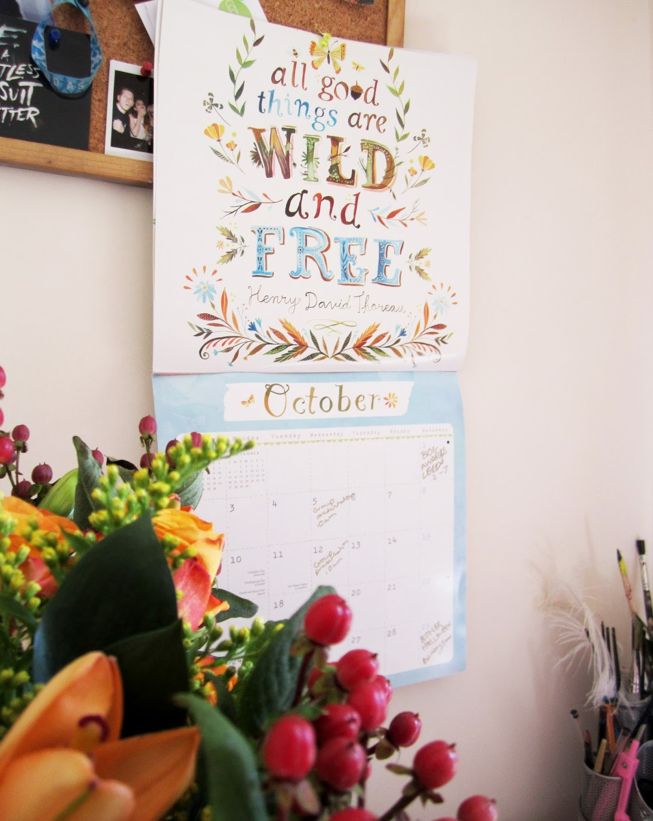 october calendar and autumnal fllowers