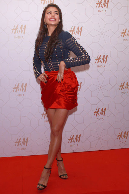 Beautiful Bollywood Actress Jacqueline Fernandez Hot In Red Mini Short Navel Queens