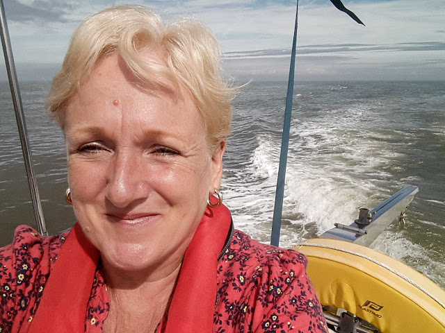 Photo of me enjoying the sunshine on Ravensdale's aft deck in the Solway Firth