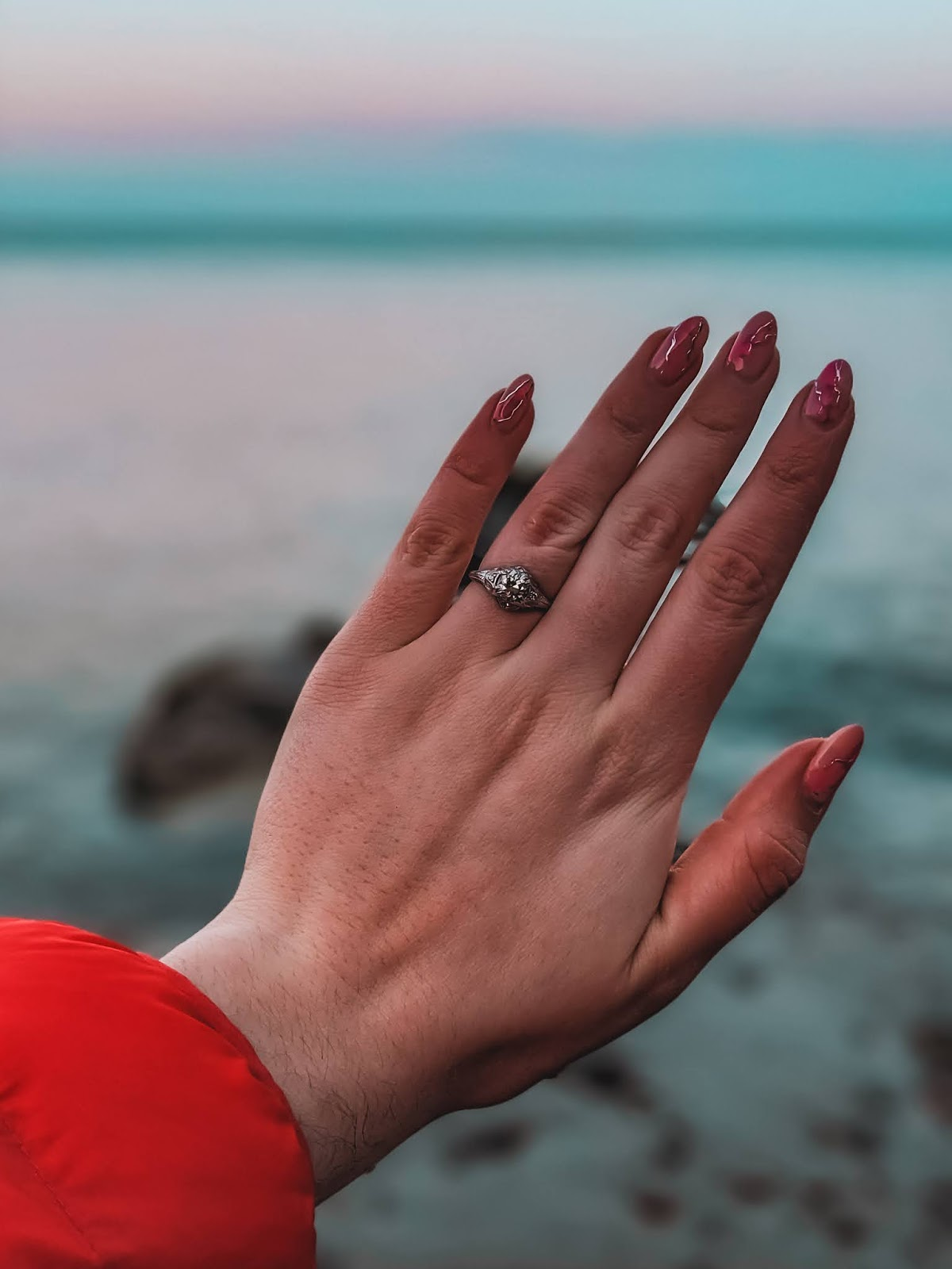 art deco engagement ring beach sunset manicure sea