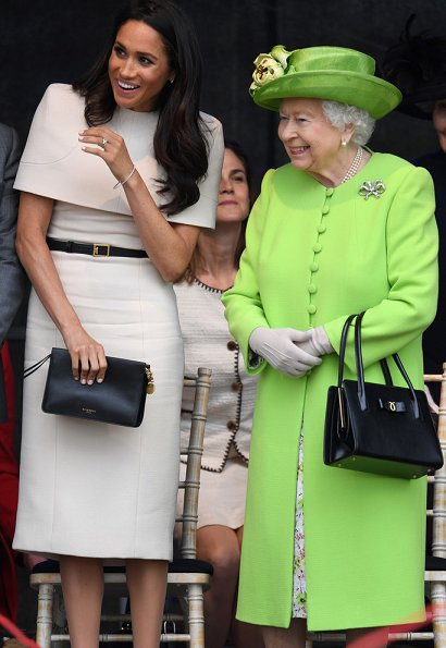 Duchess Meghan Markle is wearing bespoke Givenchy and Sarah Flint shoes, she carried Givenchy bag for today's events in Cheshire