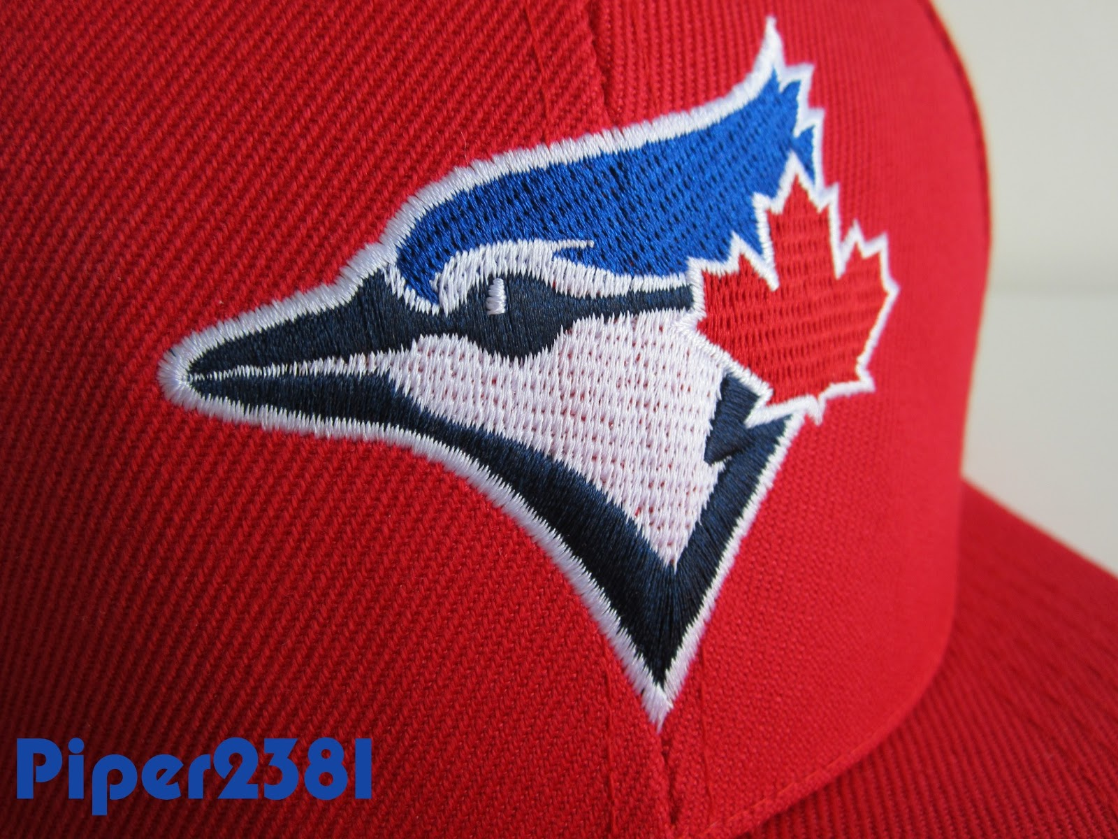 b9906de4d49 The hat colorway is red with the current Blue Jay logo on the front. On the  back you have Honda stitched in white