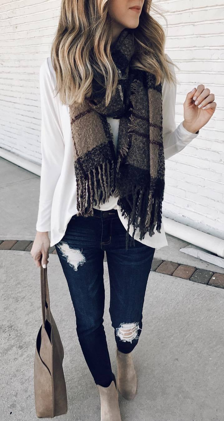 what to wear with a scarf : white blouse + rips + bag + boots