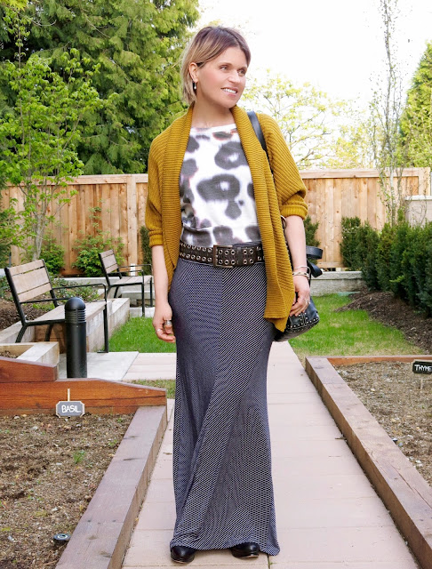 styling a cropped, patterned sweatshirt with a striped maxi-skirt and drapey cardigan