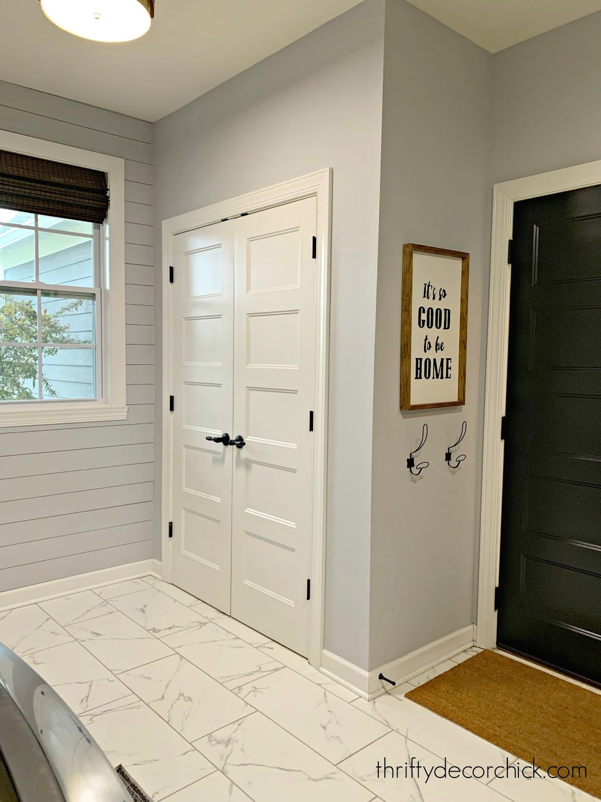 Laundry/mud room with closet for vacuums